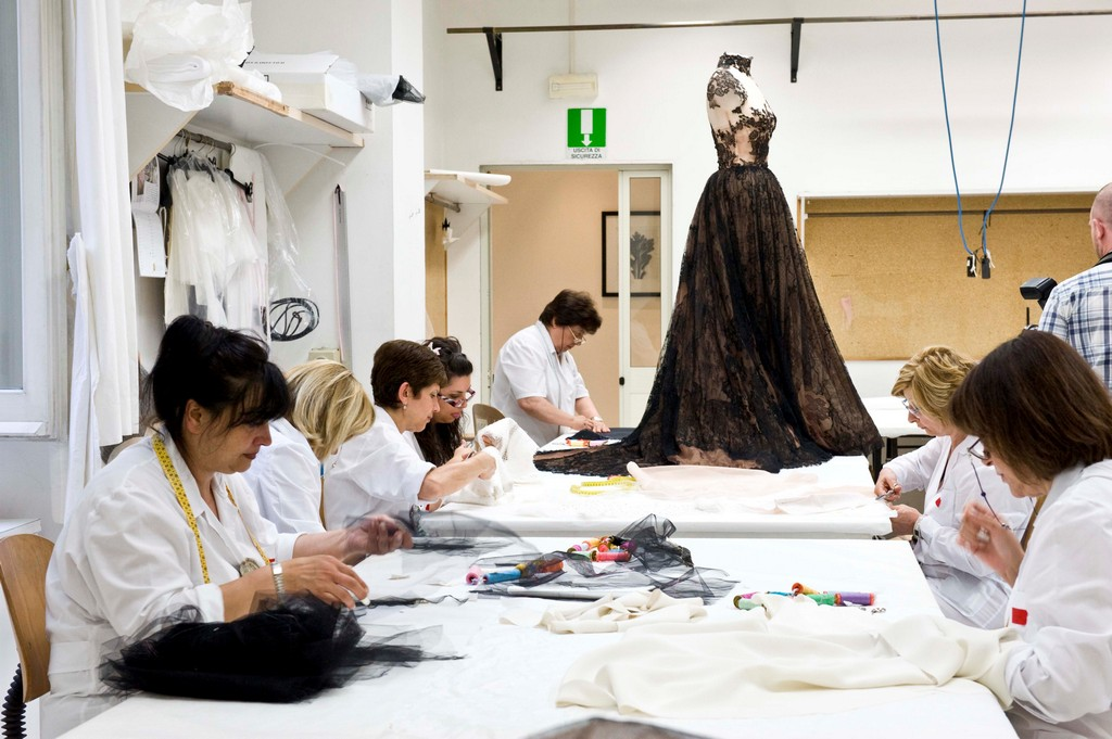 Tailors working at the atelier of Valentino, photo by Agostino Fabio